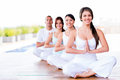 Group of people doing yoga exercises and smiling Royalty Free Stock Images