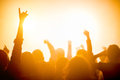 Group of people enjoying a concert silhouettes with raised hands at nightclub Royalty Free Stock Image