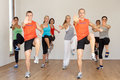 Group of people exercising in dance studio facing camera Stock Image