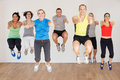 Group of people exercising in dance studio smiling to camera Royalty Free Stock Images