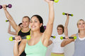 Group of people exercising in dance studio with weights facing camera Stock Image