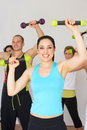Group of people exercising in dance studio with weights smiling to camera Royalty Free Stock Photography