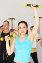 Group of people exercising in dance studio with weights smiling to camera Royalty Free Stock Images