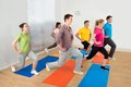 Group Of People Exercising On ...