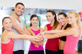 Group of people in the gym celebrating victory fitness sport training success and lifestyle concept happy Stock Photos