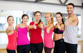 Group of people in the gym showing thumbs up fitness sport training and lifestyle concept happy Royalty Free Stock Photography