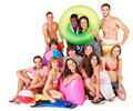 Group people holding beach accessories. Stock Photos
