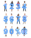 Group of people holding blue numeral in a row Stock Photos