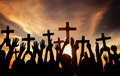 Group of People Holding Cross and Praying in Back Lit Royalty Free Stock Photo