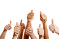 Group of people holding thumbs up holds many and congratulates the winner Stock Image