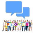 Group of people holding word people multi ethnic alphabet to form and speech bubbles above Stock Image