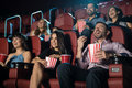 Picture : Group of people laughing at the movie theater hands