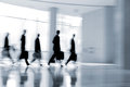 Group of people in the lobby business center abstakt image a modern with a blurred background and blue tonality Stock Photography