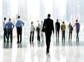 Group of people in the lobby business center abstract image a modern with a blurred background Stock Photos