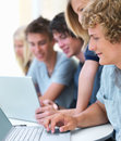 Group of people looking into laptop Stock Images