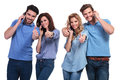 Group of people making the ok sign on the phone casual young thumbs up while talking Stock Images
