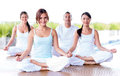 Group of people meditating in a yoga studio Stock Photo