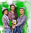 Group people paint wall at home happy Stock Photography