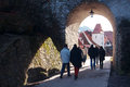 stock image of  Group of people passed through the arch in Krumlov