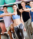 Group of people with perfect figures exercise at the gym in a fitness class Stock Photography