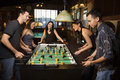 Group of People Playing Foosball Royalty Free Stock Photo