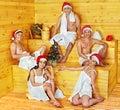 Group people in santa hat at sauna relaxing Stock Photos