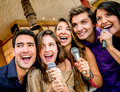 Group of people singing happy karaoke at the bar Royalty Free Stock Photo