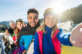 People Group With Snowboard And Ski Resort Snow Winter Mountain Cheerful Friends Taking Selfie Photo