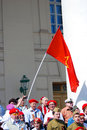 A group of people stand with a red soviet flag there are war veterans and young they celebrate victory day on the theater Royalty Free Stock Photos