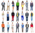 Group of people standing in a row isolated on white Stock Photos
