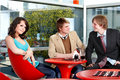 Group of  people talking in cafe. Stock Image