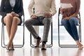 Group of people waiting for job interview, sitting on chairs Royalty Free Stock Photo