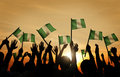 Group of People Waving Flag of Nigeria Royalty Free Stock Photo