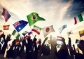 Group of People Waving Flags in World Cup Theme Royalty Free Stock Photo