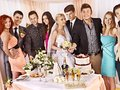 Group people at wedding table with cake Stock Photography