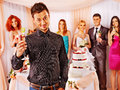 Group people at wedding table with cake Stock Images