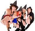 Group of people in  witch costume with thumbs up. Stock Photos