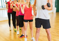 Group of people working out with dumbbells in gym fitness sport training and lifestyle concept the Stock Image