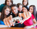 Group photo young people taking picture of themselves with camera selfpic series Stock Photography