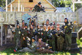 Group portrait of big happy company playing paintball Royalty Free Stock Photo