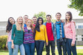 Group portrait of college students in the park young standing Royalty Free Stock Image