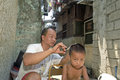 Group portrait Filipino father, the barber, and son