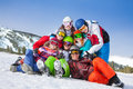 Group portrait of friends wearing goggles cheerful women and men holding each other in hug on the mountains background Royalty Free Stock Image