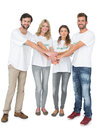 Group portrait of happy volunteers with hands together over white background Royalty Free Stock Images