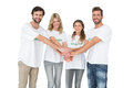 Group portrait of happy volunteers with hands together over white background Stock Images