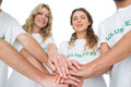 Group portrait of happy volunteers with hands together over white background Royalty Free Stock Photo