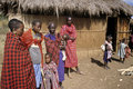 Family Maasai tribe, two women in draped robe, and  child.
