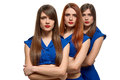 Group portrait of three serious women. triplets sisters Royalty Free Stock Photo