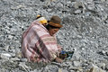 Group portrait of working grandma with grandchild bolivia elderly indian woman is searching between the waste the mine corporacion Royalty Free Stock Photography