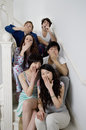 Group portrait of young friends yawning Royalty Free Stock Photo